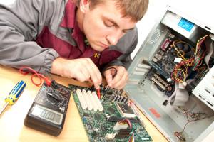 rowlett technician repairing computer